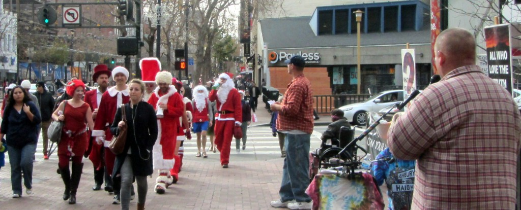 Brandon preaches at 5th and Market. Thousands of people dressed as Santa for the 21st annual SantaCon convention.